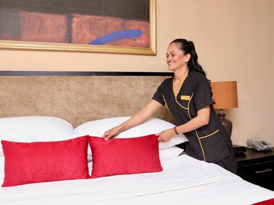 Picture of a maid making a bed at the Costa Rica Medical Center Inn, San Jose, Costa Rica.
