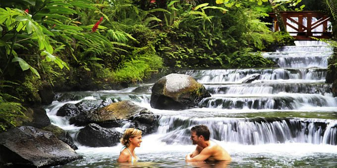 Picture of a happy couple enjoying Costa Rica's Hot Springs.