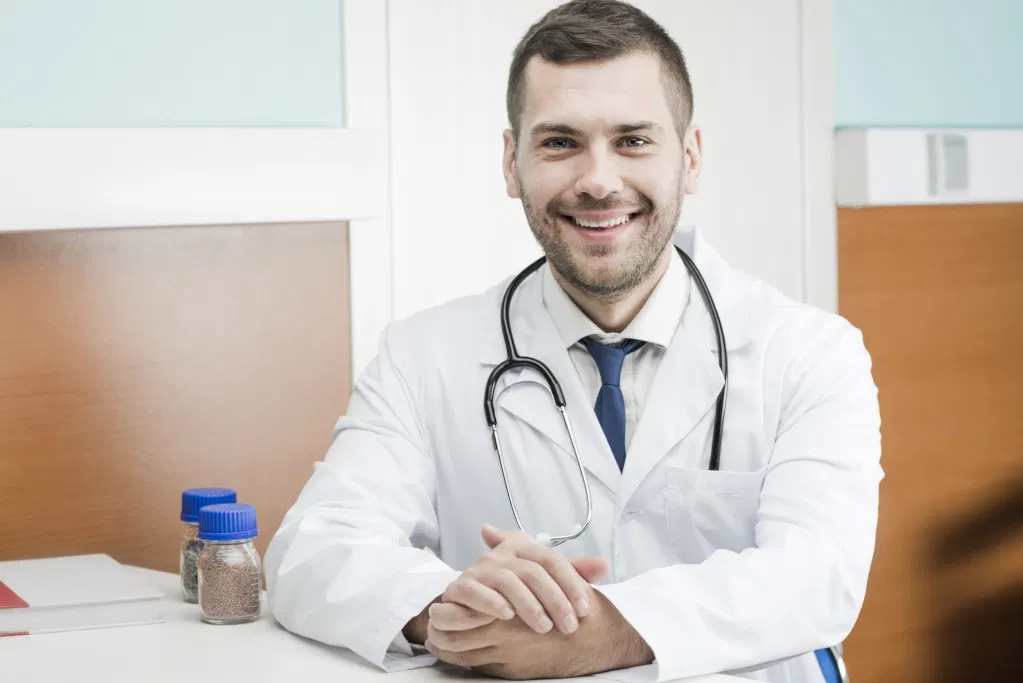 Picture of a smiling medical doctor.